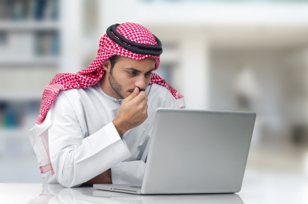 abudhabi: Arabian businessman working in his office