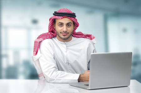 abudhabi: Arabian Business man using notebook in the office