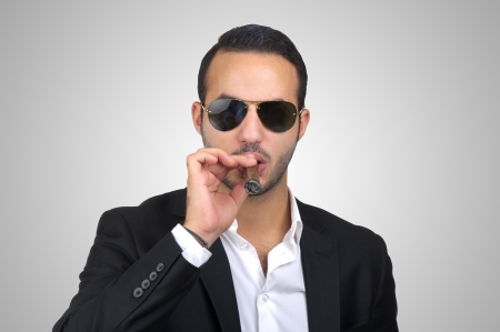 Sexy man smoking cigar isolated photo