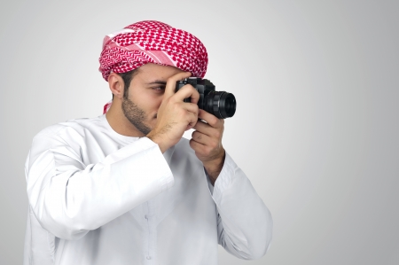 eatern: Arabian photographer taking pictures isolated