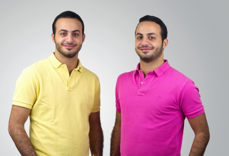 identical: Identical twins portraits shot against white background Stock Photo