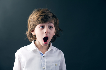 young beautiful kid with a shocking expression Stock Photo - 25067154