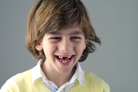toothless: Portrait of a smiling toothless boy