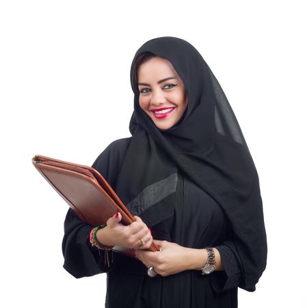 KSA: Beautiful Arabian woman holding a folder isolated on white Stock Photo