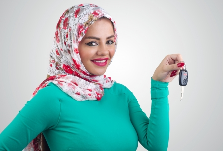 Arabian woman holding car keys photo
