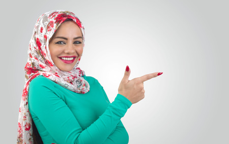 Young Arabian woman pointing her finger photo