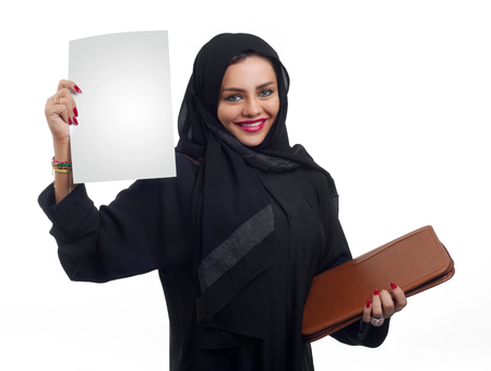 arab model: Arabian business woman holding a folder isolated on white Stock Photo