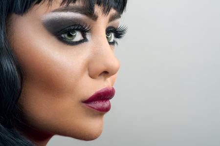 smokey: Brunette Woman close-up Portrait , Makeup Stock Photo