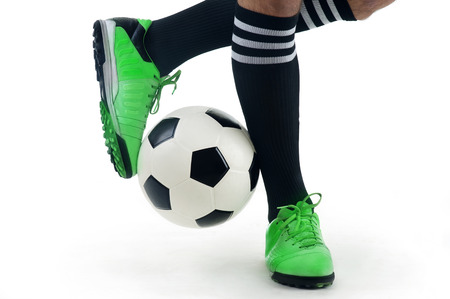 soccer cleats: Close-up of a player s feet playing the ball Editorial