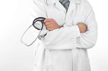 Close-up of a doctor holding a stethoscope with his arms crossed photo