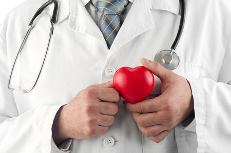 heart doctor: Doctor holding a red heart expressing care