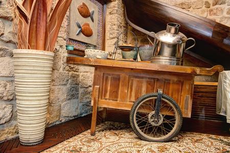 antique vase: Decorative Vintage Wooden cart with metal pot and a vase