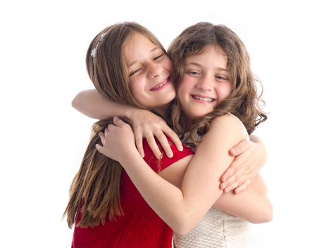 Two Beautiful Sisters hugging isolated on white  photo