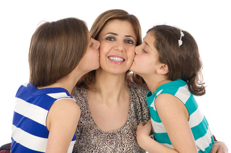 two daughters kissing their mother isolated on white
