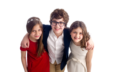 brothers and sisters: Family shot of a brother and two sisters isolated  Stock Photo