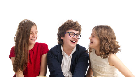 realtionship: Beautiful Portrait of Brother and two Sisters Stock Photo