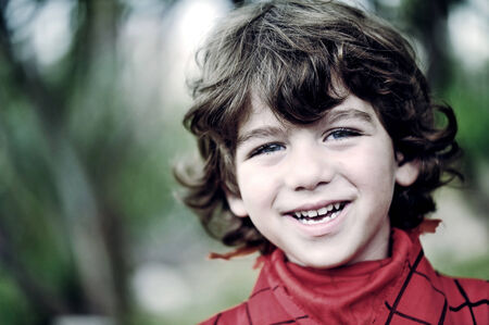 Portrait of a cute young boy outside photo