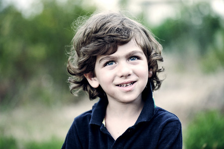 Portrait of a handsome boy outdoors photo