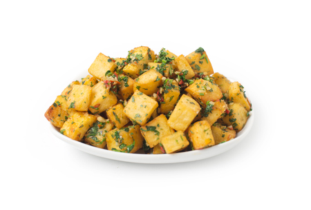 baked potato: Spicy potato cut in cubes and fried, lebanese cuisine Stock Photo