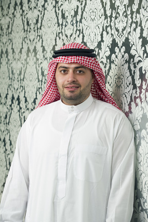 middle eastern ethnicity: Saudi Arabian young businessman posing