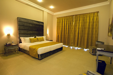 luxury hotel room: 5 stars luxury hotel room with curtains closed Stock Photo