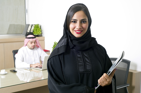 arab adult: Arabian Businesswoman with her boss on Background Stock Photo