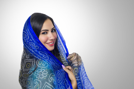 Muslim woman with headscarf in fashion concept Imagens