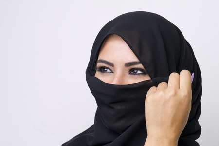 niqab: Beautiful girl wearing burqa closeup