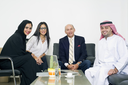 Multiracial Business Meeting in office, Arabian business people meeting with Foreigners in office Stock Photo