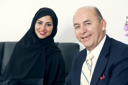 hijab: Business Meeting Between a Senior Businessman & a Woman wearing Hijab