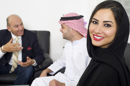 Businesspeople in office, Arabian Businesswoman wearing Hijab against colleagues meeting, Arabian Businesspeople meeting with foreigner photo