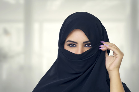 burqa: Beautiful Muslim girl wearing burqa closeup Stock Photo