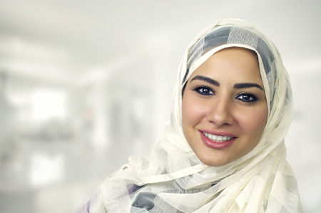 woman serious: Portrait of a beautiful Arabian Woman wearing Hijab, Muslim Woman wearing Hijab Stock Photo