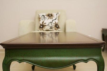 Close-up of a luxurious table , vintage solid wood furniture detail photo