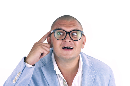 man thinking while doing a silly face with nerd glasses isolated on white photo