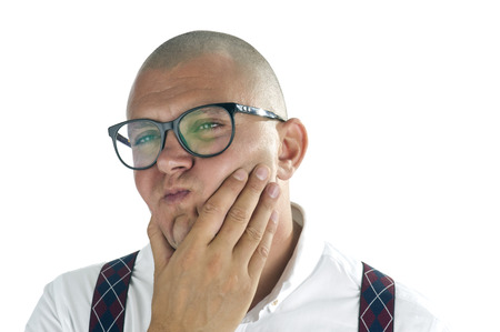 Handsome man thinking with hand on his chin, isolated on white background  Nerdy casual businessman thinking with hand on chin in his office photo