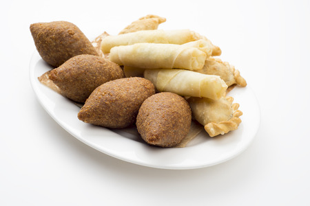 Lebanese Plate of Kebbeh , cheese rolls & meat pie isolated on white