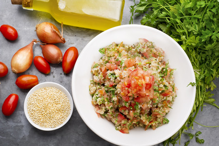 Delicious vegetarian quinoa salad with parsley, tomato and onion