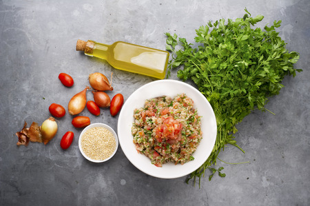 horizental: Delicious vegetarian quinoa salad with parsley, tomato and onion