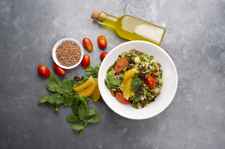 Delicious vegetarian lentil salad with lemon, mint and cherry tomato