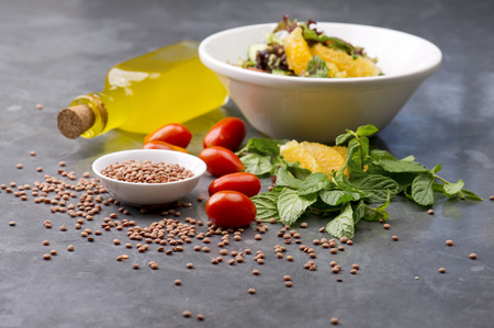 salad plate: Delicious vegetarian lentil salad with lemon, mint and cherry tomato