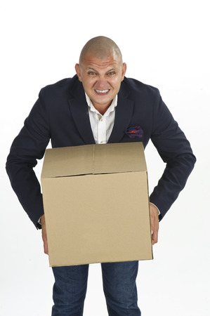 Man holding a cardboard box package photo