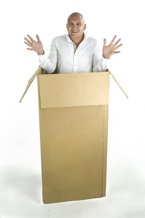 Man packed in a cardboard box photo