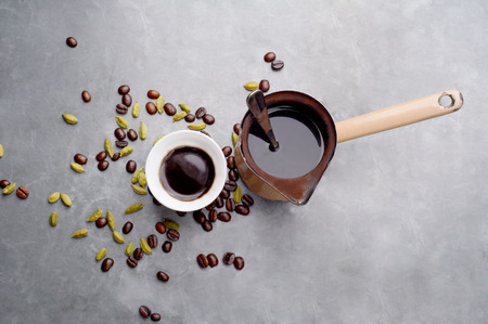 locum: Turkish Coffee with coffee beans and Cardamom scattered on a vintage background