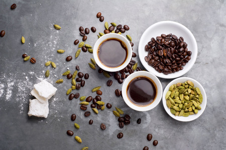 middle eastern ethnicity: Turkish Coffee with coffee beans and Cardamom scattered on a vintage background