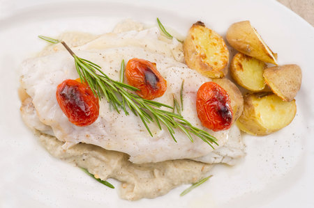 cooked fish: Fish dish - fish fillet in sauce and vegetables