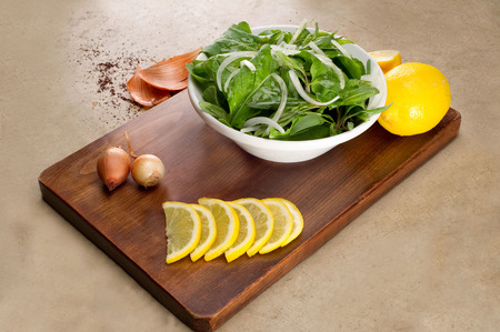 roquette: Rocket  Roquette  Arugula  Rucola salad leaves npresented with ingredients on a wooden plate Stock Photo