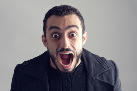Man with a surprised facial expression, Surprise, Man Screaming