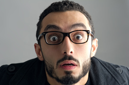 shocked: Man with a surprised facial expression, Surprise expression Stock Photo
