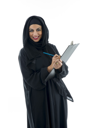 arab hijab: Arabian business woman holding a clipboard isolated on white Stock Photo